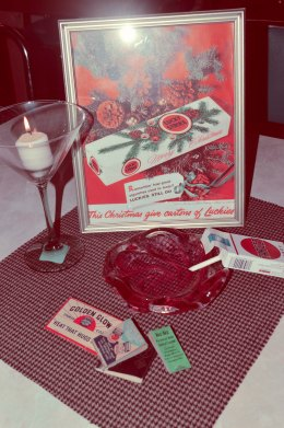 Vintage matchbooks, candy cigarettes, framed vintage ads, and martini glasses transport you to the 1960s in style